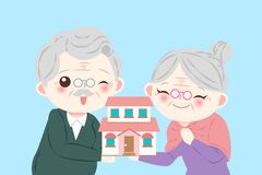 Old couple small red house. Happy old couple small red house on the blue background Royalty Free Stock Photography
