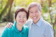 Old couple smile happily. Old couple look you and smile happily in the park Royalty Free Stock Photography