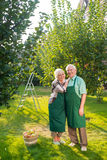 Old couple standing on grass. Royalty Free Stock Photography