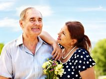 Old couple at summer outdoor. Stock Photography