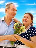 Old couple at summer outdoor. Royalty Free Stock Photography