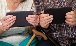 Old couple and tablet Stock Photo