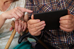 Old couple and tablet Royalty Free Stock Image