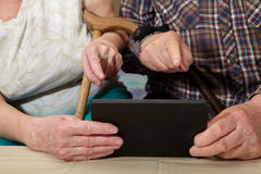 Old couple and tablet Royalty Free Stock Photo