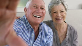 Old couple taking a selfie stock footage