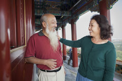 Old Couple Talking and Smiling  In Jing Shan Park Stock Photo