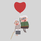 Old couple  traveling  in a heart balloon Royalty Free Stock Photography