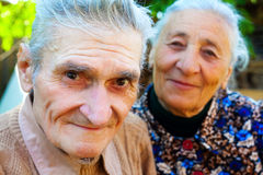 Old couple - two happy seniors royalty free stock image