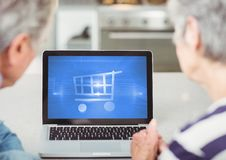Old Couple using Tablet with Shopping trolley icon royalty free stock image