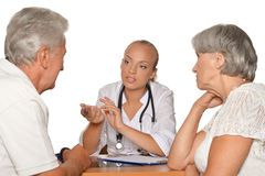Old couple visitting  female doctor Stock Photo
