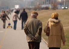Old Couple Walking 2. Old man walking with his wife Royalty Free Stock Photos