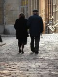 Old couple walking home. Old couple walking in old town (gamla stan), stockholom, sweden Stock Photo