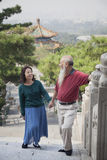 Old Couple Walking In Jing Shan Park, Holding Hands Stock Images