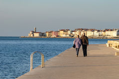 Old couple walking by the sea side Stock Image