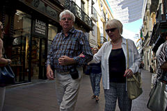 An old couple walking in the street 34 Royalty Free Stock Photos