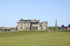 Old course at Saint Andrews. ST ANDREWS, UK-JULY 22: People walking on the old golf course at St. Andrews in Scotland in front of the famous clubhouse. The stock image