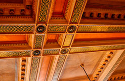 Old Courtroom Ceiling. The spectator section of an old, preserved courtroom stock image