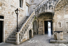 Old courtyard. With a staircase and a well in Trogir Croatia Royalty Free Stock Image