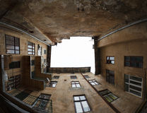 Old courtyard of the city Lviv. Against overcast sky Stock Photo
