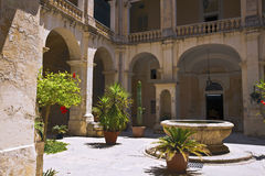 Old courtyard in the city of Mdina. Stock Photos