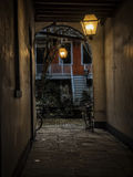 Old Courtyard. Old New Orleans courtyard with glowing lamps Royalty Free Stock Photo
