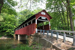 Old covered bridge. On rural country road Stock Photos