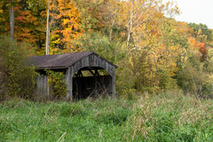 Old covered bridge in autumn Stock Photo