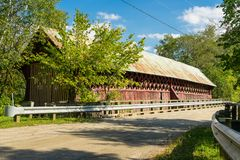 An old covered bridge in rural Quebec. An old, condemned covered bridge in the Eastern Townships region of Quebec royalty free stock photo