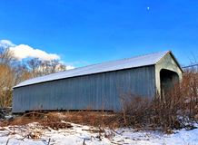 Old covered bridge in Sheffield. Old covered bridge with blue sky background in Sheffield, Massachusetts in winter united states Royalty Free Stock Images
