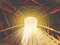 Old covered bridge in Sheffield. Sunlight going inside old covered bridge on Covered Bridge Lane in Sheffield, Massachusetts united states Royalty Free Stock Photos