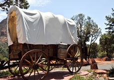 Old covered wagon days of pioneers. Vintage covered wagon from days of western pioneers Royalty Free Stock Image