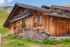 Old cow bells under the roof of an Alpine mountain hut, Switzerland. Old cow bells under the roof of an Alpine mountain hut. Switzerland stock images