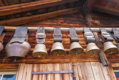 Old cow bells under the roof of an Alpine mountain hut, Switzerland. Old cow bells under the roof of an Alpine mountain hut. Switzerland royalty free stock images