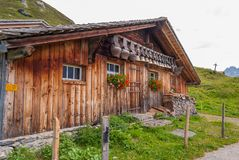 Old cow bells under the roof of an Alpine mountain hut, Switzerland. Old cow bells under the roof of an Alpine mountain hut. Switzerland stock photography