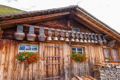 Old cow bells under the roof of an Alpine mountain hut, Switzerland. Old cow bells under the roof of an Alpine mountain hut. Switzerland royalty free stock photos