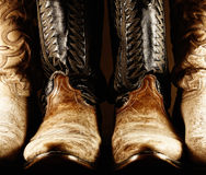 Old Cowboy Boots - High Contrast. High contrast photo of several pairs of old cowboy boots, with the center pair being a matched pair royalty free stock image