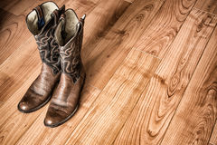 Old Cowboy Boots on Wood Floor Royalty Free Stock Image