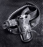 Old Cowboy Gun. Old cowboy 45 pistol and leather tooled holster in black and white Stock Photography