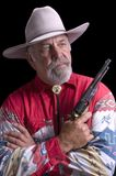 Old Cowboy holding gun Royalty Free Stock Image