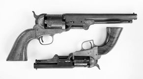 Old Cowboy Pistols. Two old western six shooter cowboy pistols in black and white Royalty Free Stock Photography