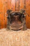 Old cowboy saddle on hay Royalty Free Stock Photo