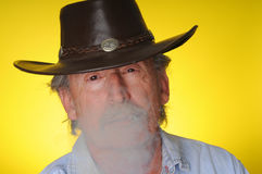 Old Cowboy smoking Stock Photo