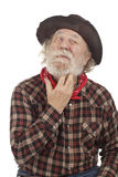 Old cowboy thinks and scratches whiskers Royalty Free Stock Photography