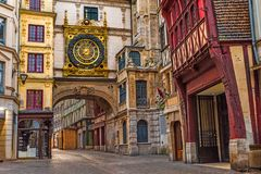 Old cozy street in Rouen with famos Great clocks or Gros Horloge of Rouen, Normandy,France. Old cozy street in Rouen with famos Great clocks or Gros Horloge of stock images