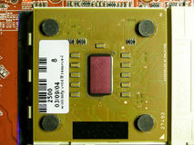 Old CPU mounted on socket view from above stock photography