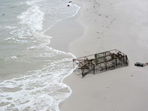 Old Crab trap in sand beach. Old lobster and crab pot on seaside Stock Photography