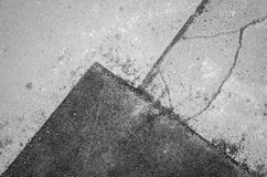 Old cracked asphalt road with repaired segment Royalty Free Stock Photo