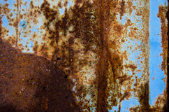 Old cracked blue painted and rusty  tin background Stock Photography