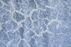 Old cracked blue relief plaster on wall closeup. Old cracked blue coarse relief plaster on wall closeup stock photo