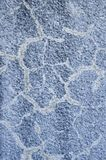 Old cracked blue relief plaster on wall closeup. Old cracked blue coarse relief plaster on wall closeup royalty free stock images